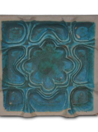 Etruscan tiles have a copper blue carbonate glaze or a white glaze.