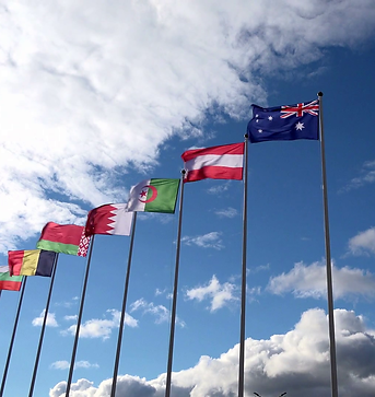 various-world-flags-flying-on-flagpoles-