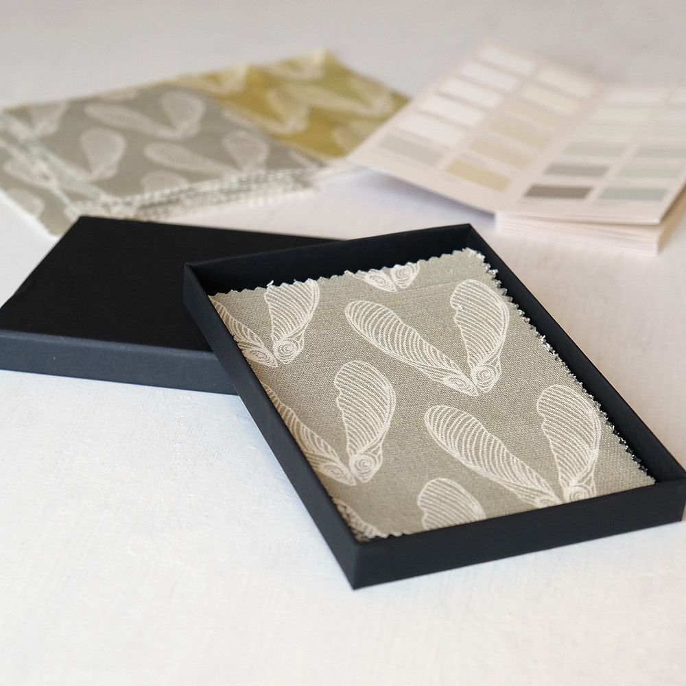 Fabric samples in a display box