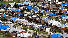 """img src=""""blueemergecytarps.jpg"""" alt=""""area of several homes covered with tar after strom damage in Houston"""">"""