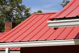 "img src=""redmetalroof.jpg"" alt=""standing seam metal roof  on Spring TX house"">"