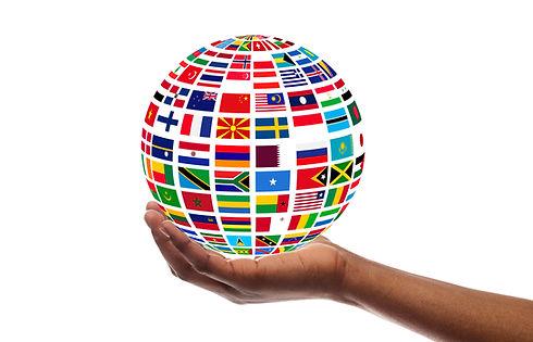 Young guy holding globe made of internat