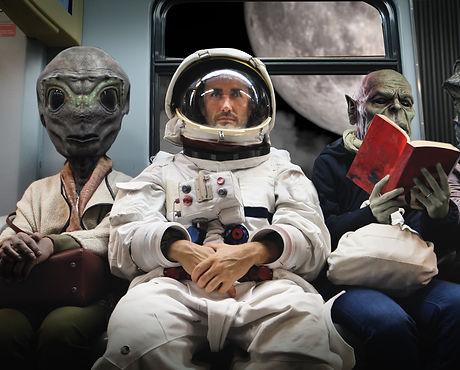 On a spaceship, an astronaut, sitting al