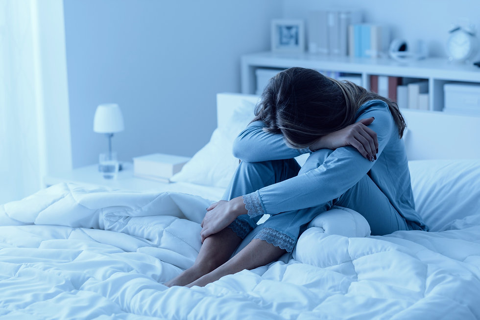 Depressed woman awake in the night, she is exhausted and suffering from insomnia_edited.jpg