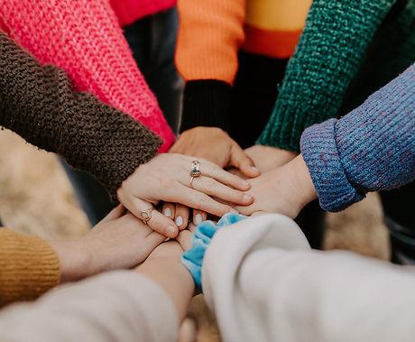 girl friends hands piled togethger_edited.jpg