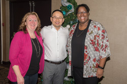 Dr. Chong and his team managers at a Christmas party