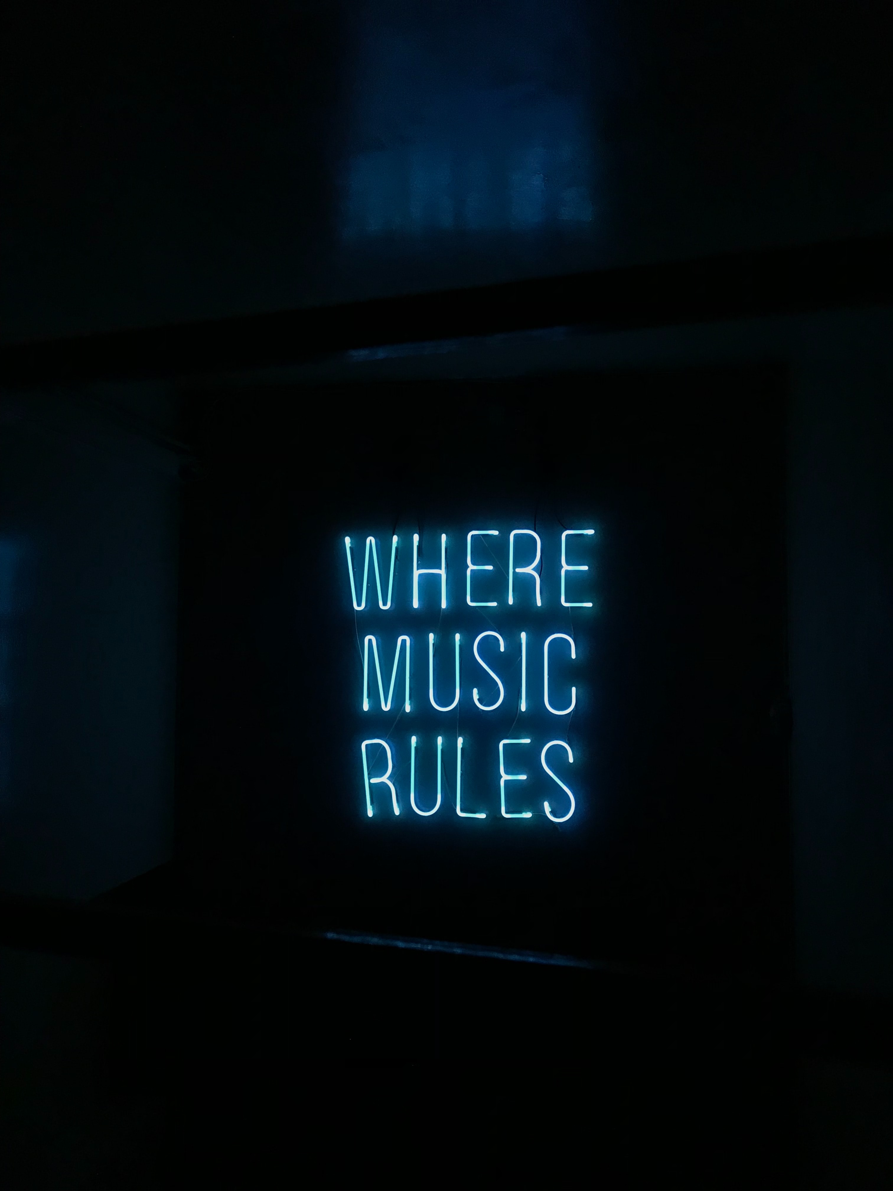 Where music rules neon sign