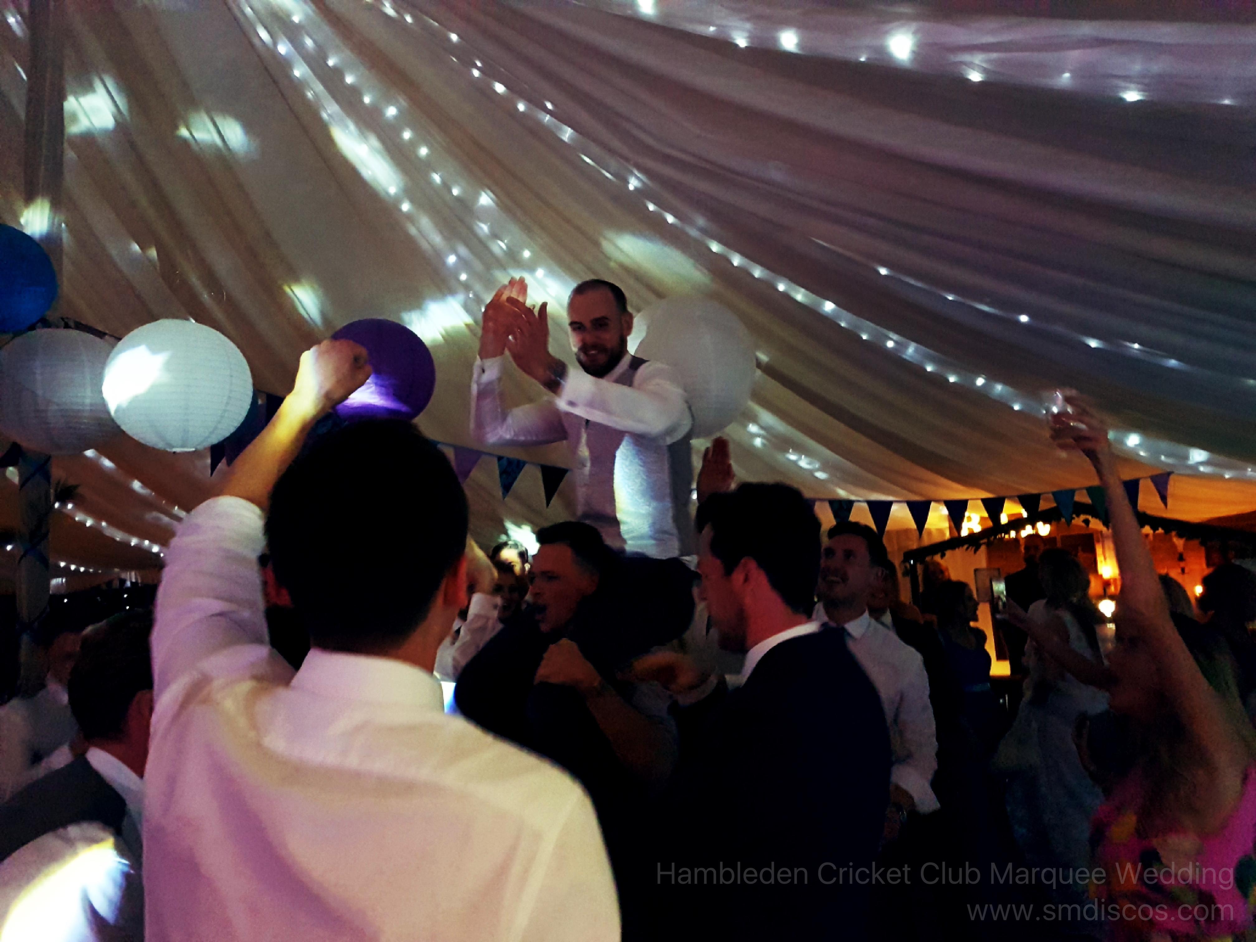 Crowd surfing groom