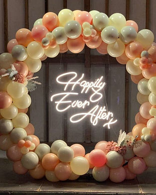 neon happily ever after sign.jpeg