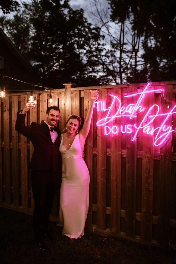 Til death do us party neon wedding sign.
