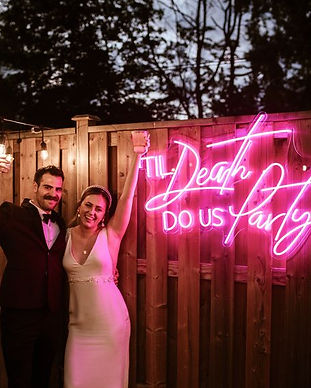 Til death do us party neon wedding sign.