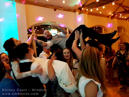 crowd surfing bride and groom.jpg