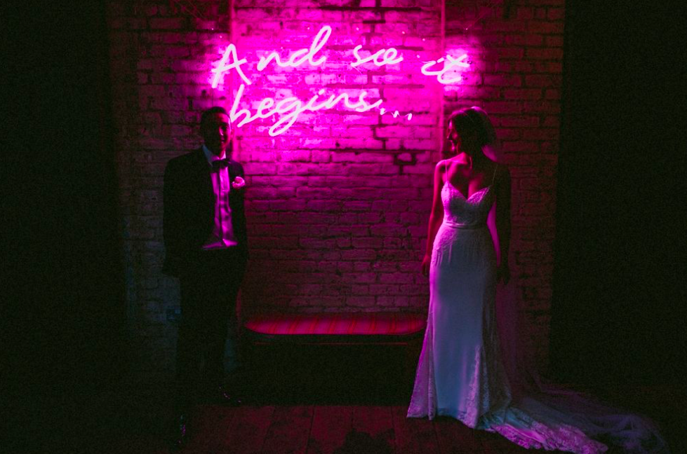and so it begins neon wedding