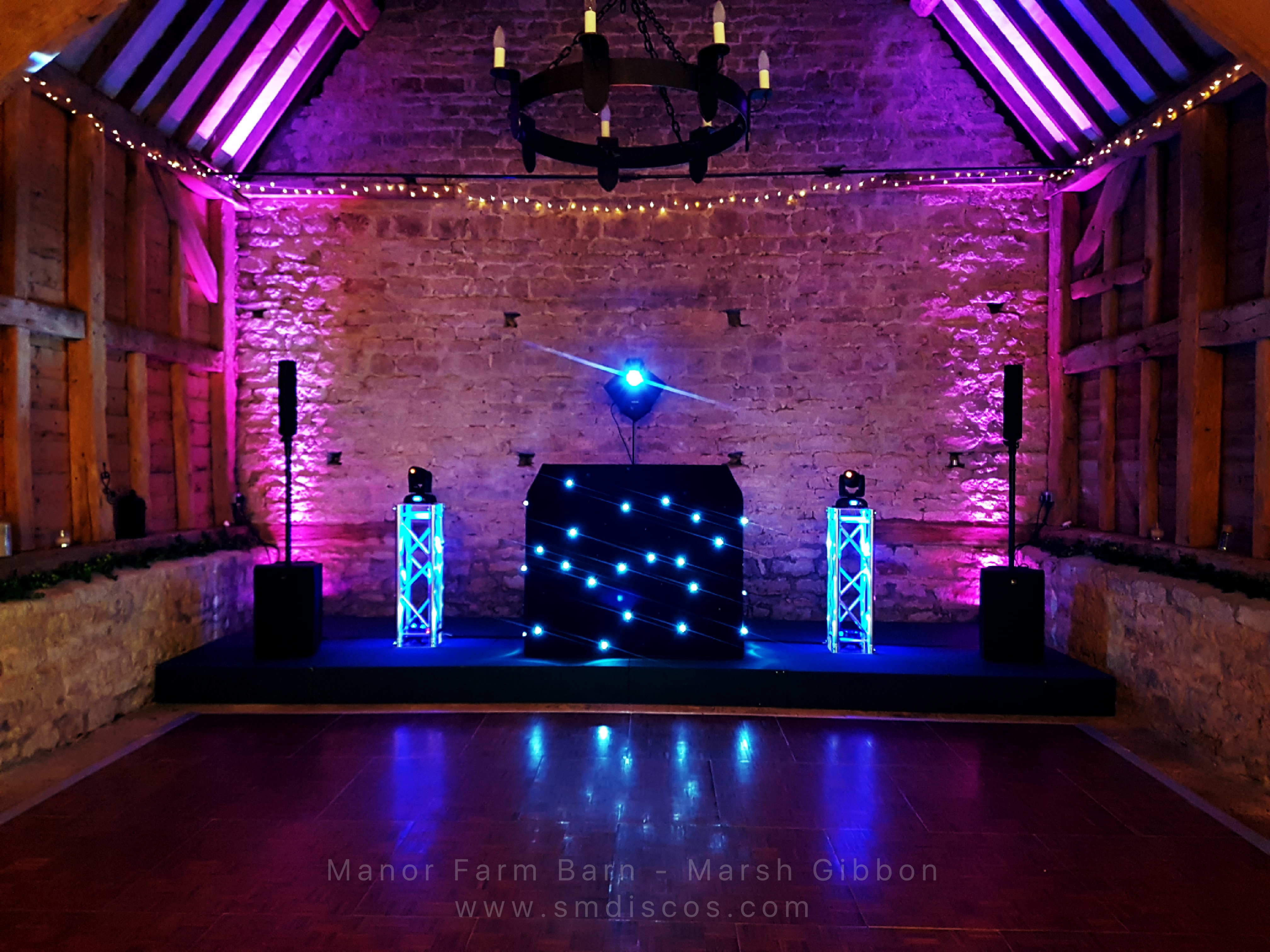 Wedding DJ rig & booth with mood lighting at Manor Farm Barn