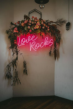neon wedding sign love rocks.jpg