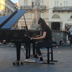Perfect Symmetry Between Two Strangers And A Piano...