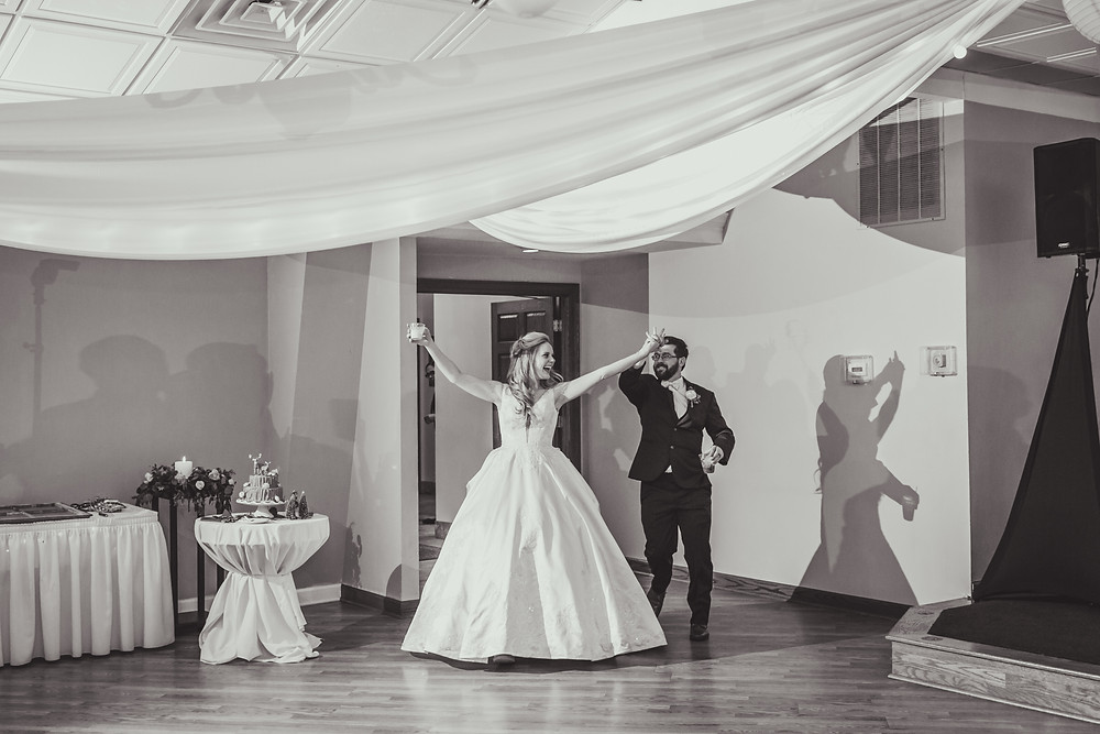 Bride and groom entrance, Riverview Banquets Batavia IL, Composed and Exposed Photography, Wedding photographer located in Batavia IL,