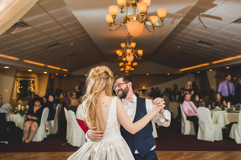 Fun bride and groom first dance, Riverview Banquets in Batavia IL, Composed and Exposed Photography, Wedding photographer,