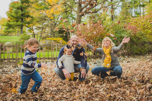 Playing in leaves. Fun fall family photos. Taken at Fabyan Forest Preserve in Geneva IL. Composed and Exposed Photography