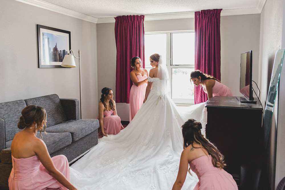 Bride and bridesmaids getting ready, Gorgeous bride, wedding dress, wedding dress train, Composed and Exposed Photography, Wedding photographer located in Kane County,