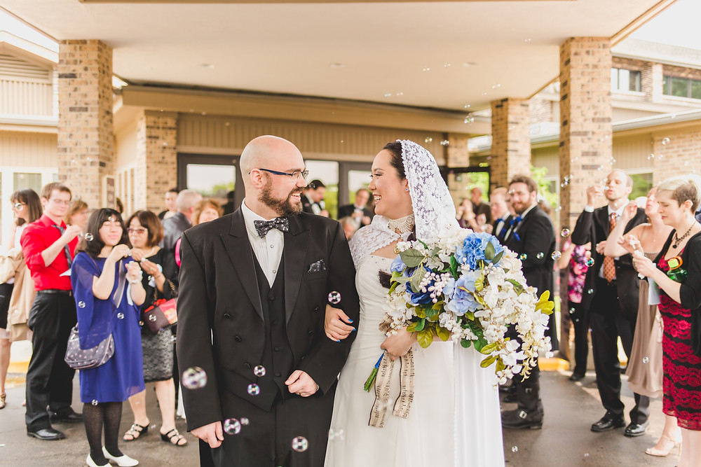 After ceremony candid bubbles. 10 Things to Ask Your Wedding Photographer