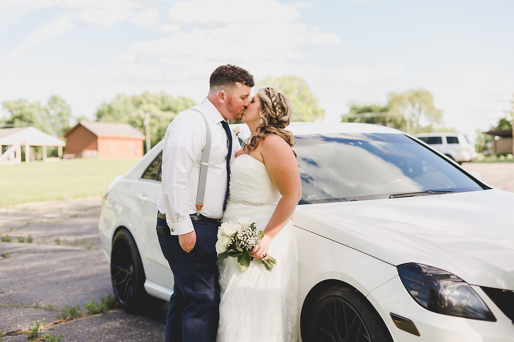 Bride and groom with car, micro wedding,