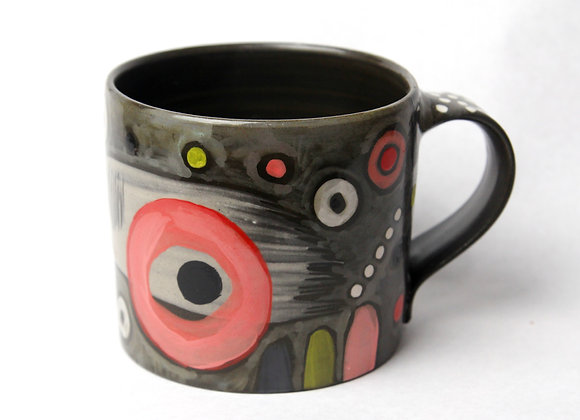 Black clay mug in pinks