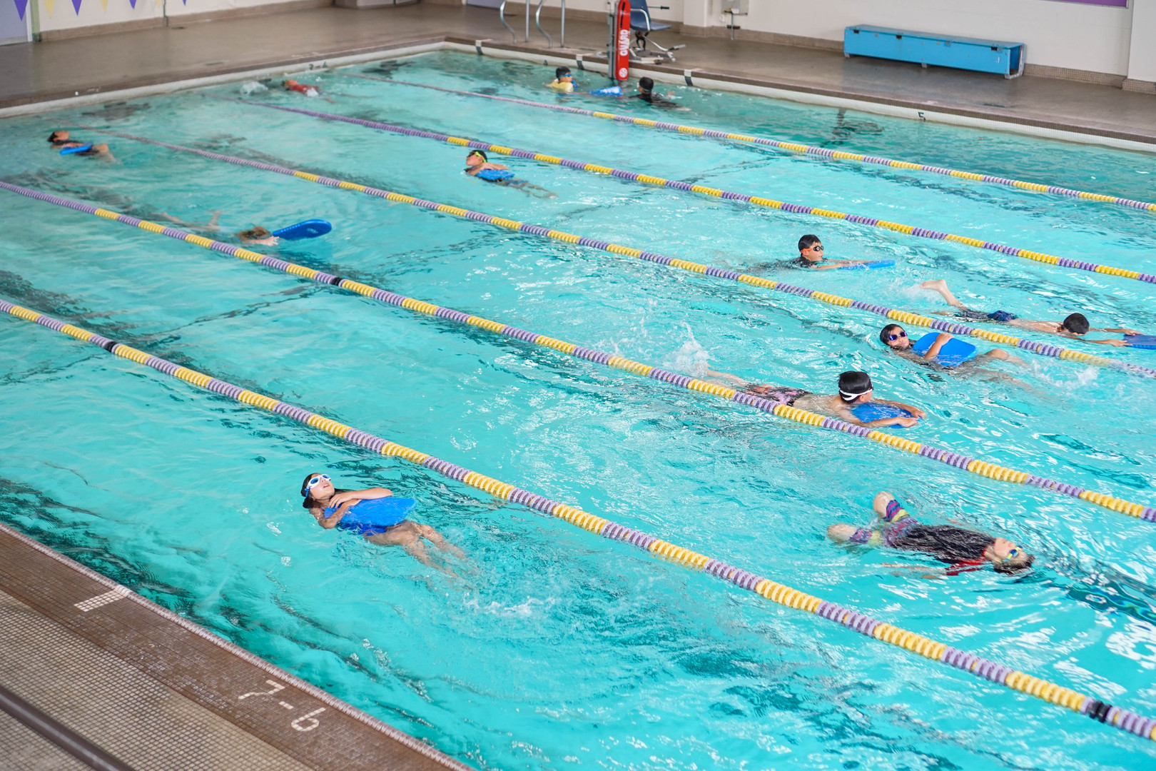 Our kids practicing swim kicks