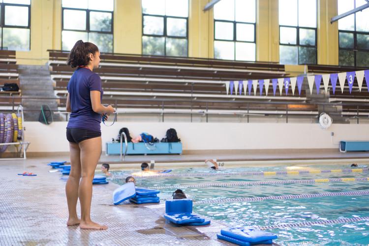 Coach Kristina teaching swimming lessons