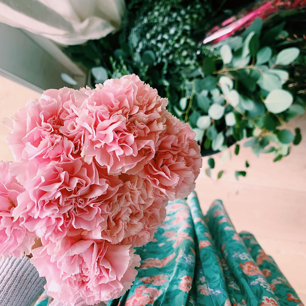 Pink carnations, green gum.