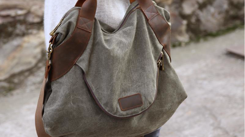 Spacious Canvas Handbag, exterior front pocket, interior zip pockets.