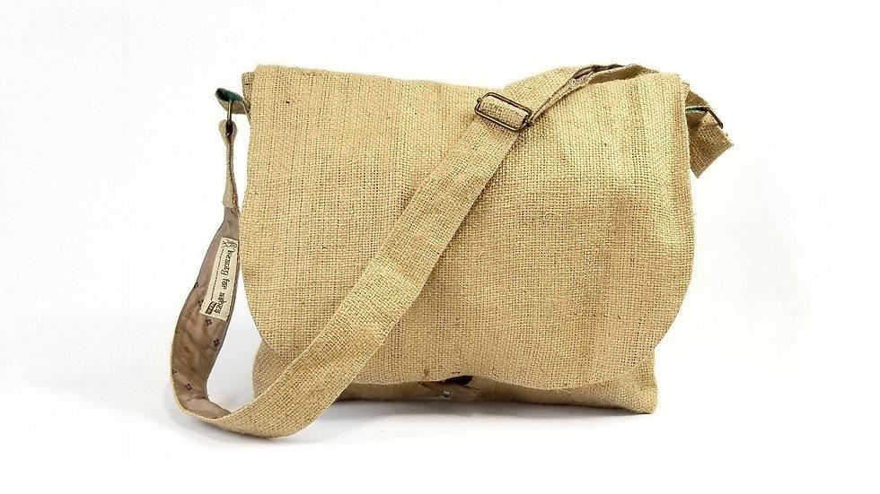 Burlap Messenger Bag, two pockets, adjustable strap and button fasten.