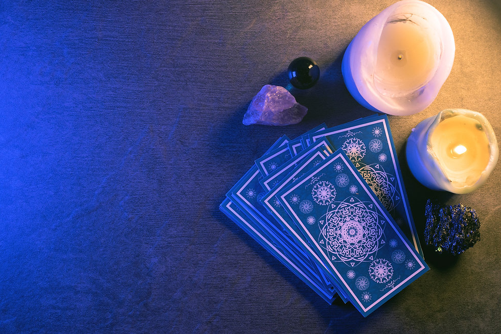 Tarot cards on stone table background. F