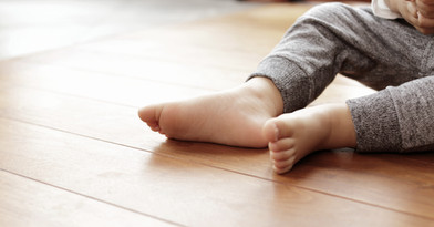 Foot of Baby Boy on Hardwood Floor
