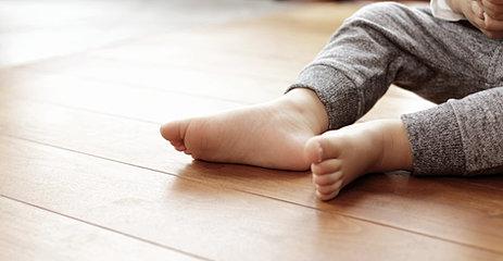 Foot Of Baby On Warm Floor