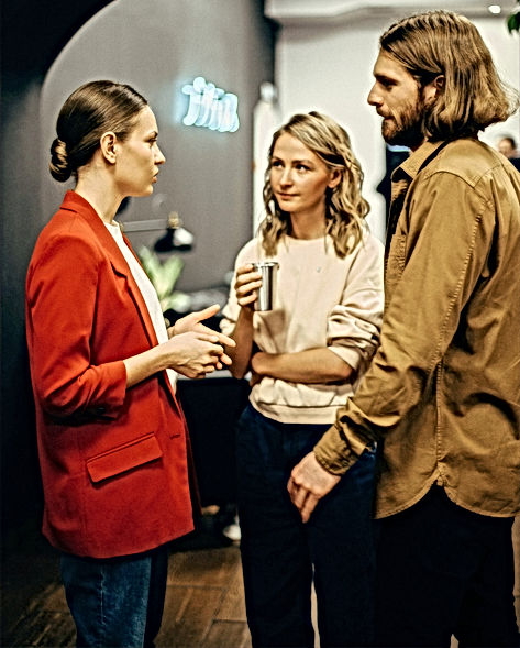 two-women-and-man-talking-3201718_edited