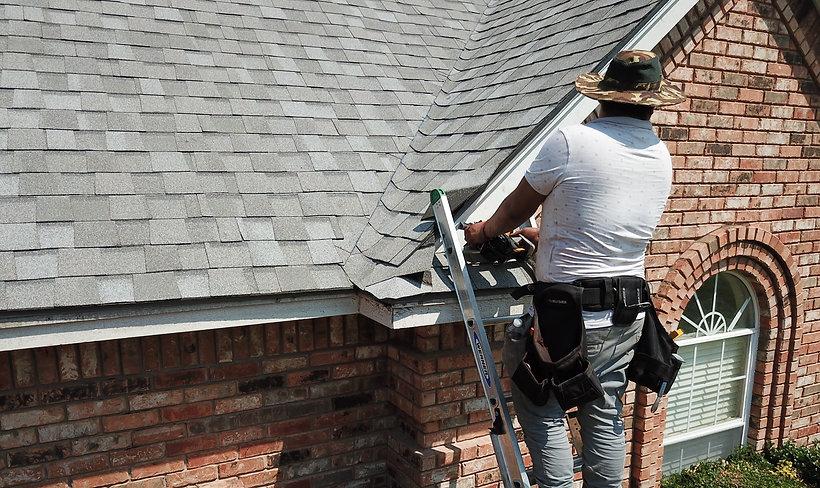 Roofer on a ladder