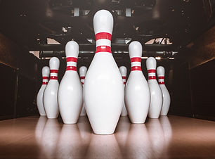 Canva - bowling pins, balls and shoes.jp
