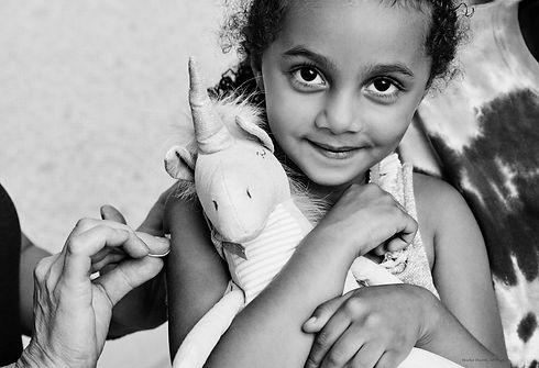 BW little girl with unicorn photo credit