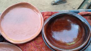 To design a low-cost portable kiln for rural small-scale pottery with a smoke extractor to improve p