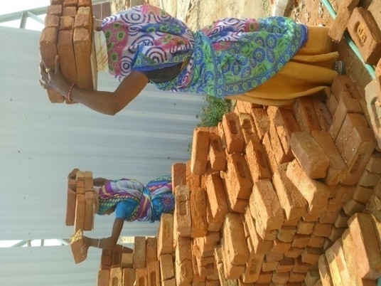 Designing a brick carrying device for improving ergonomics and efficiency of labourers at constructi