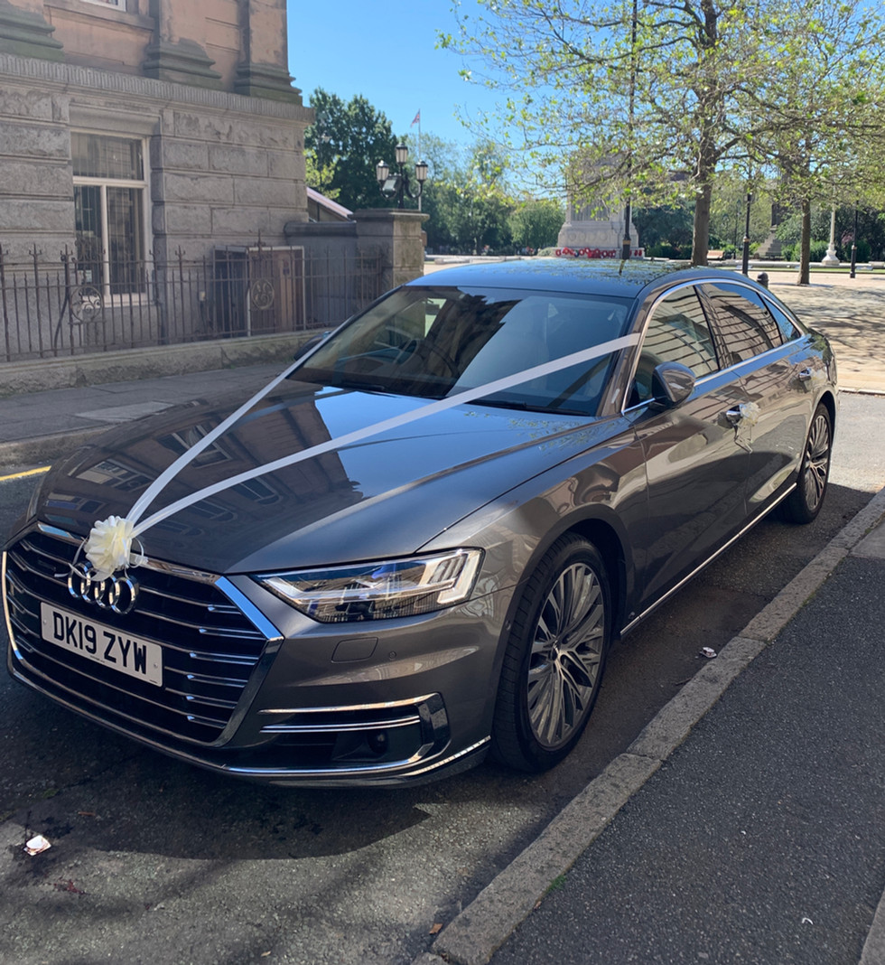Wedding in Audi A8L with ribbons and bow
