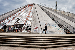 Unlikely positions in unlikely places yoga pyramid tirana