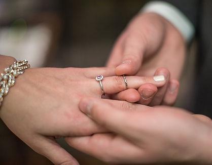 Sliding on the wedding ring.jpg