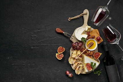 two-glasses-red-wine-tasty-cheese-plate-