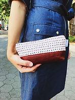 triangle-print-leather-makeup-bag.jpg