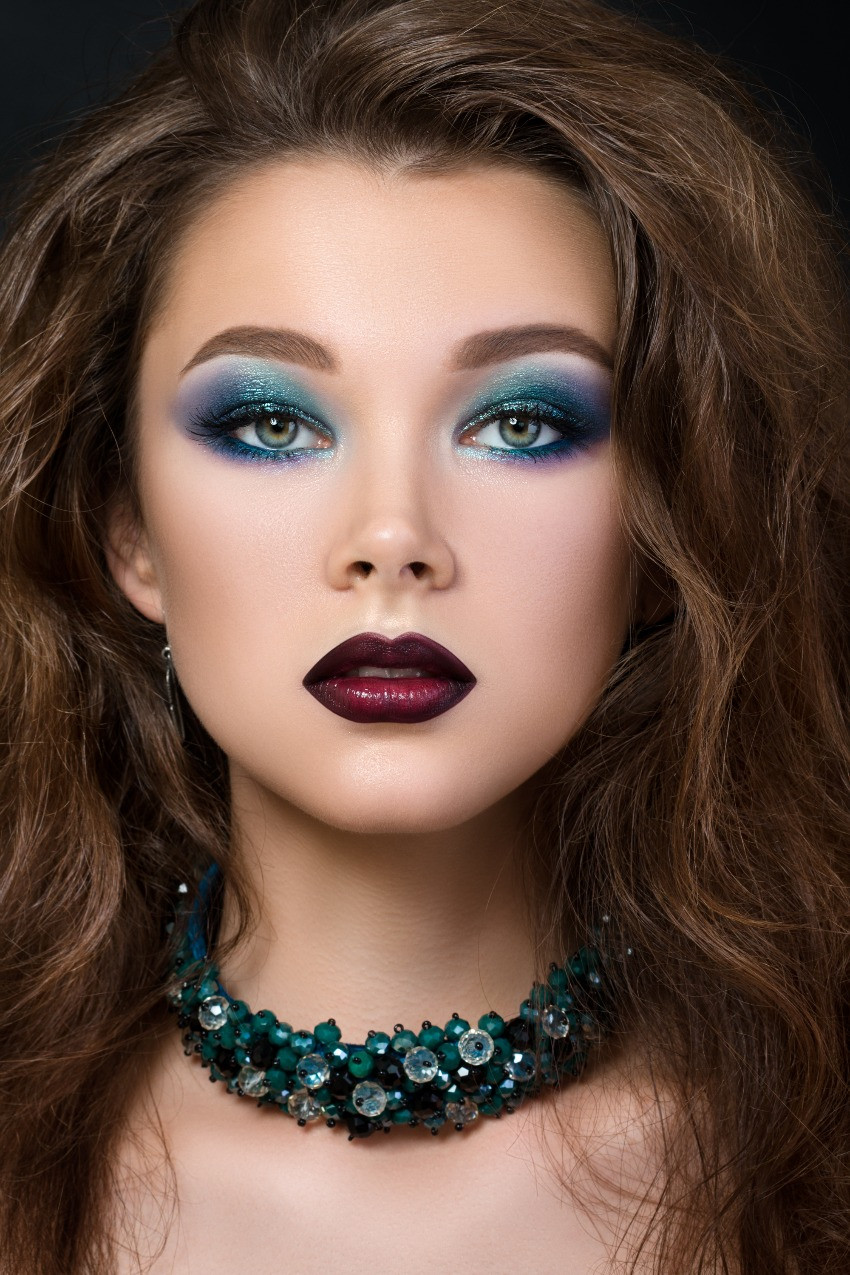 navy blue and green eye makeup on woman