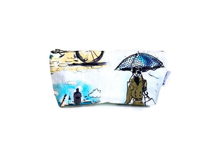Makeup Bags Made in the USA - woman with umbrella print makeup bag