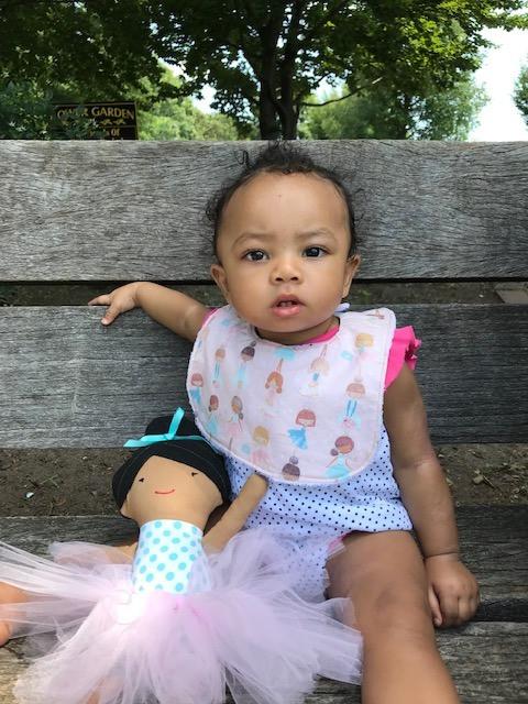 Baby Girl with Ballerina Print Bib and Fabric Doll