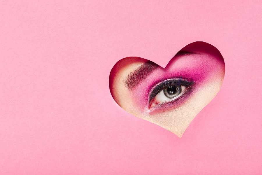 pink and white eye makeup on woman